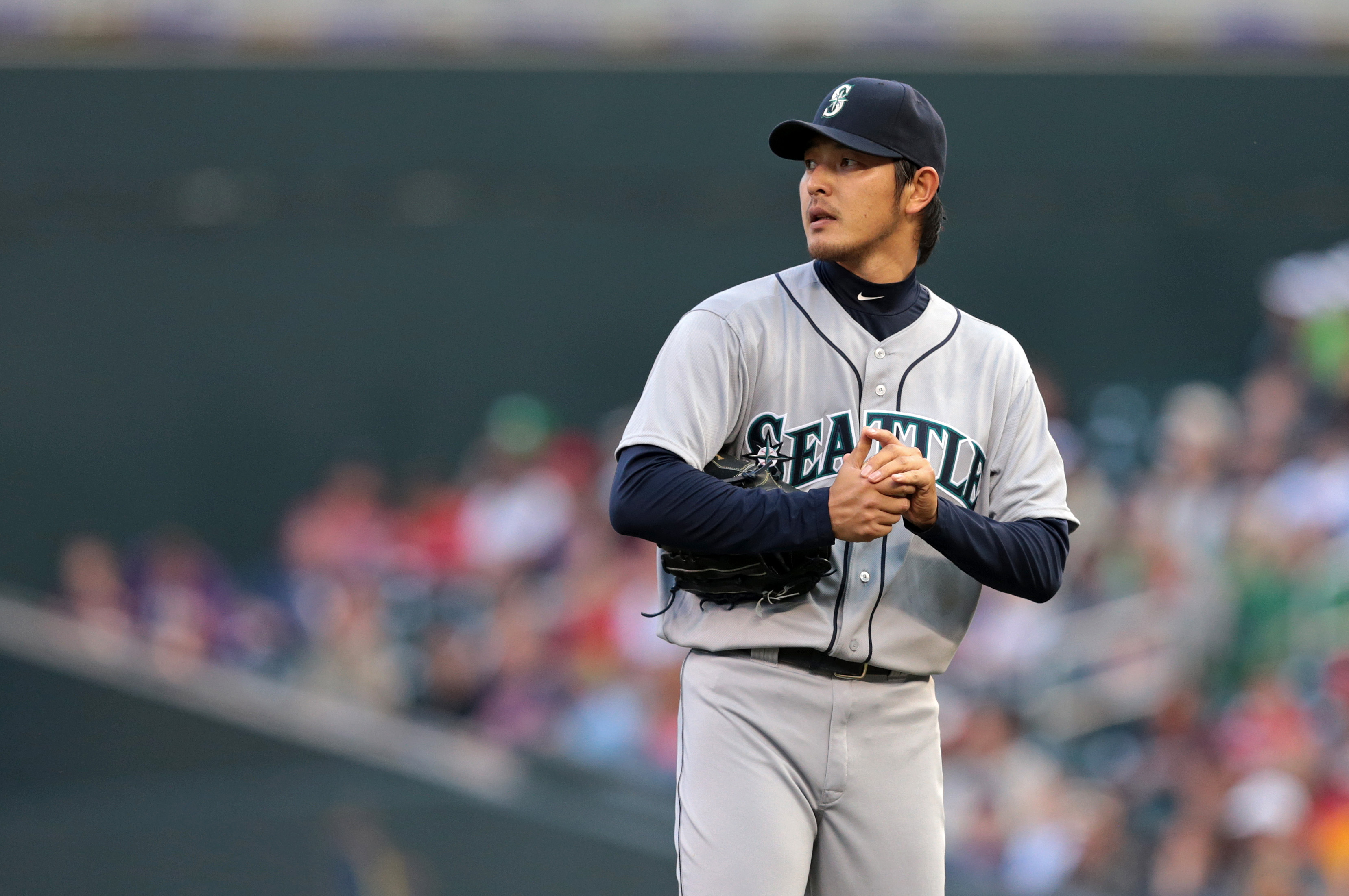 Hisashi Iwakuma belongs in the discussion of MLB's elite arms. (USAT)