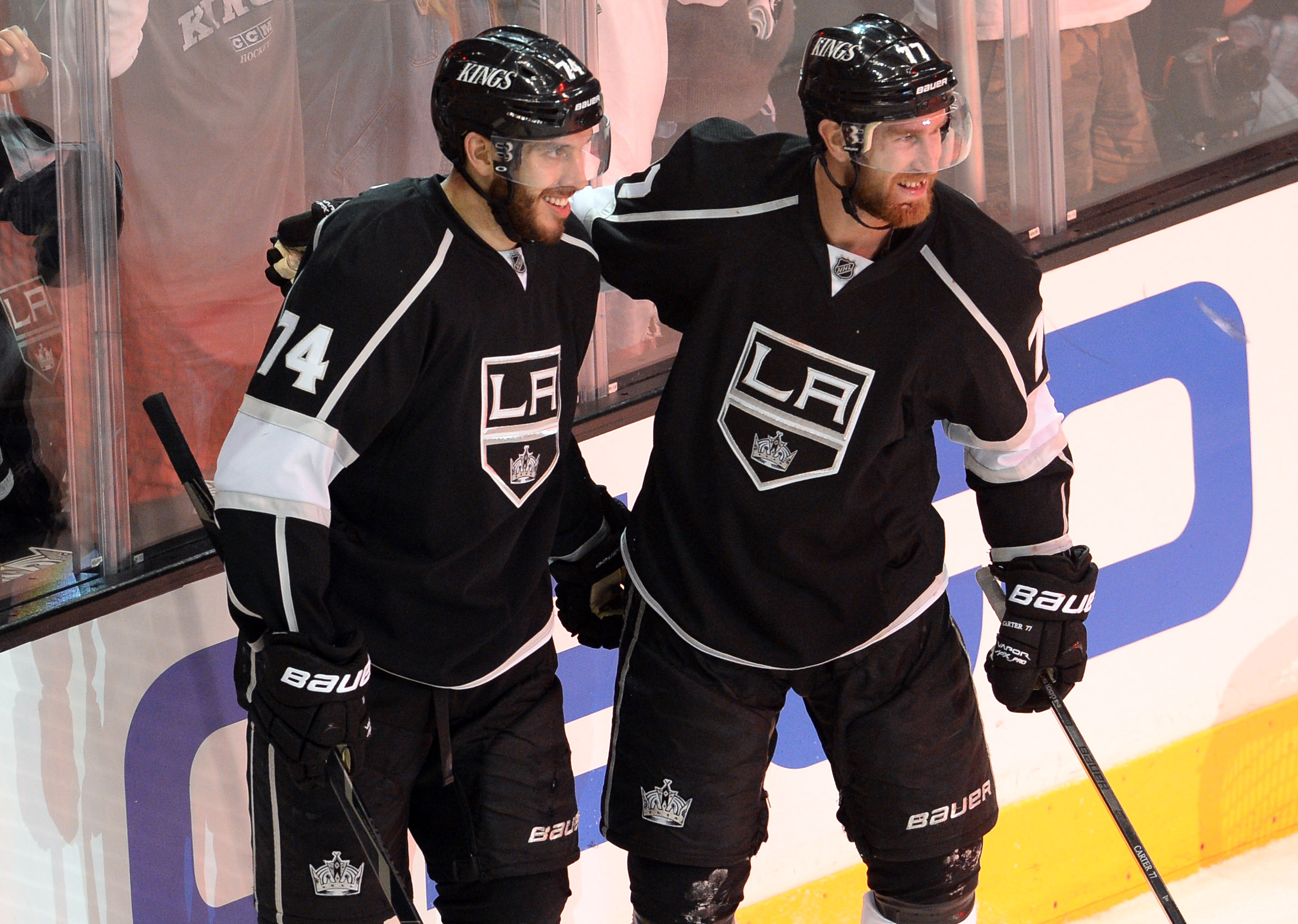 Kings center Jeff Carter (right) left Game 3 with some stitches after getting hit by Duncan Keith. (USA Today Sports)
