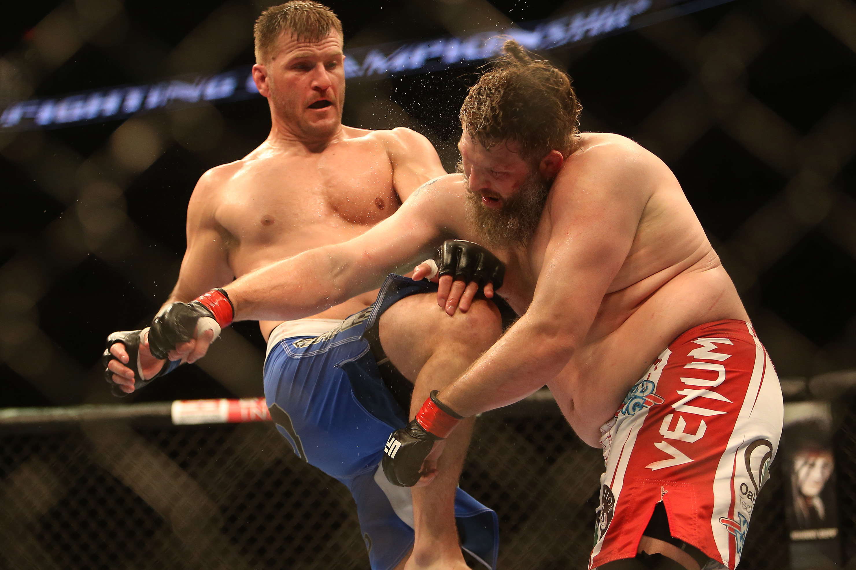 Roy Nelson takes a knee from Stipe Miocic during their heavyweight fight at UFC 161. (USA Today)