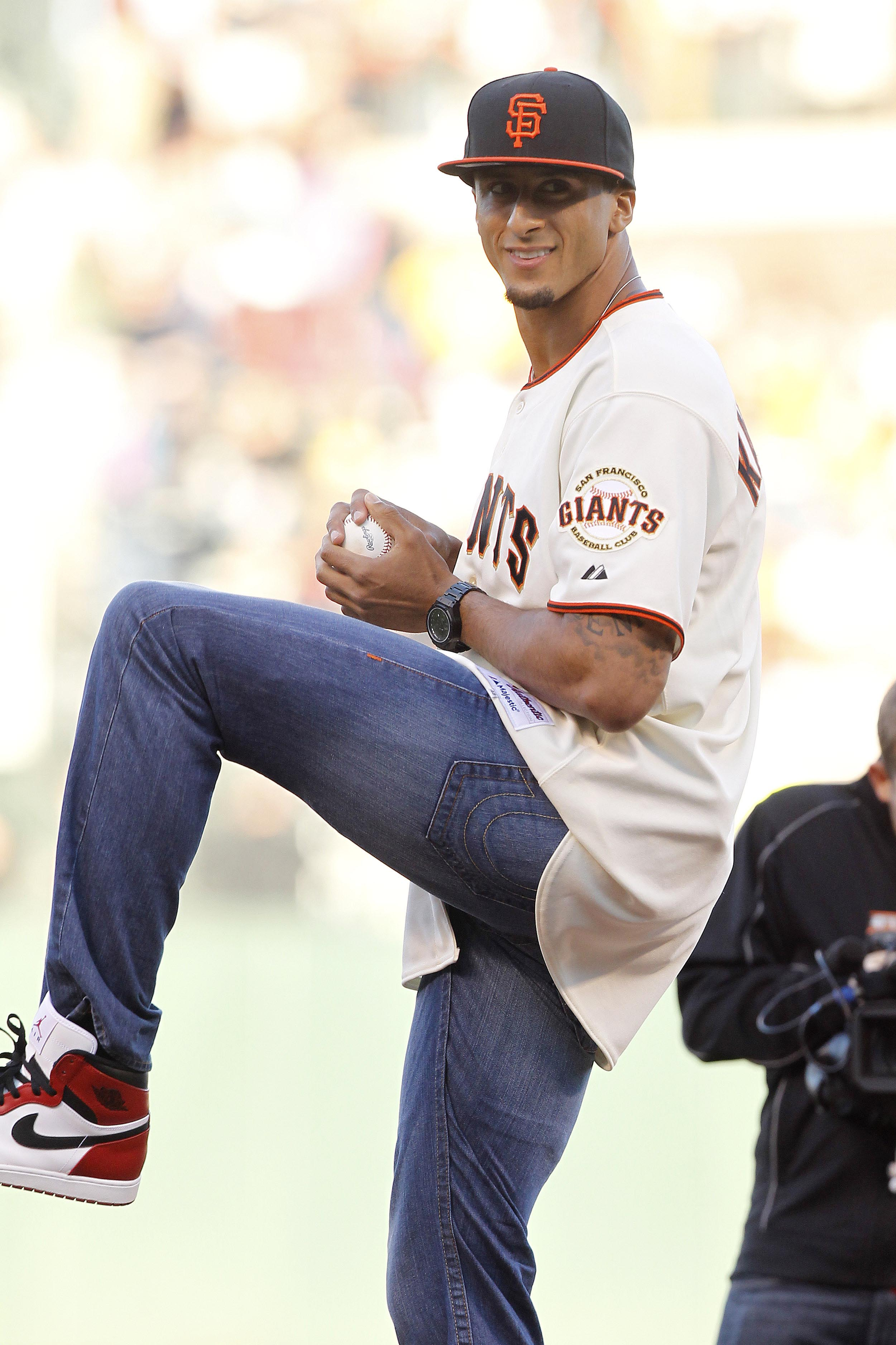 Colin Kaepernick tossed a ceremonial first pitch before the start of a Giants-Marlins game last month. (USAT)