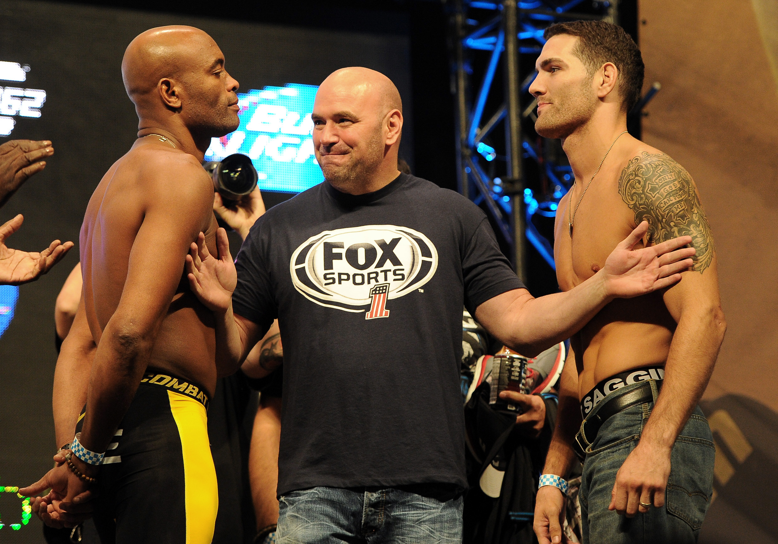 Dana White separates Anderson Silva and Chris Weidman at the UFC 162 weigh-in. (USA Today)
