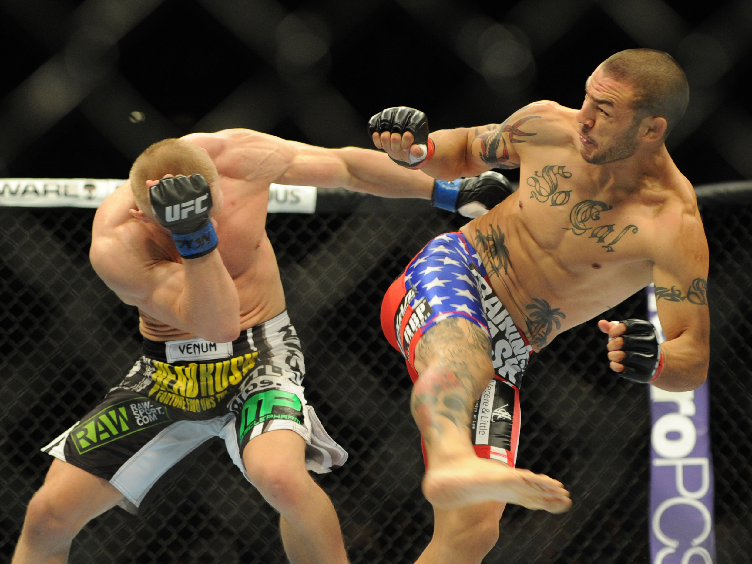 Cub Swanson kicks at Dennis Siver during their featherweight fight. (USA Today)