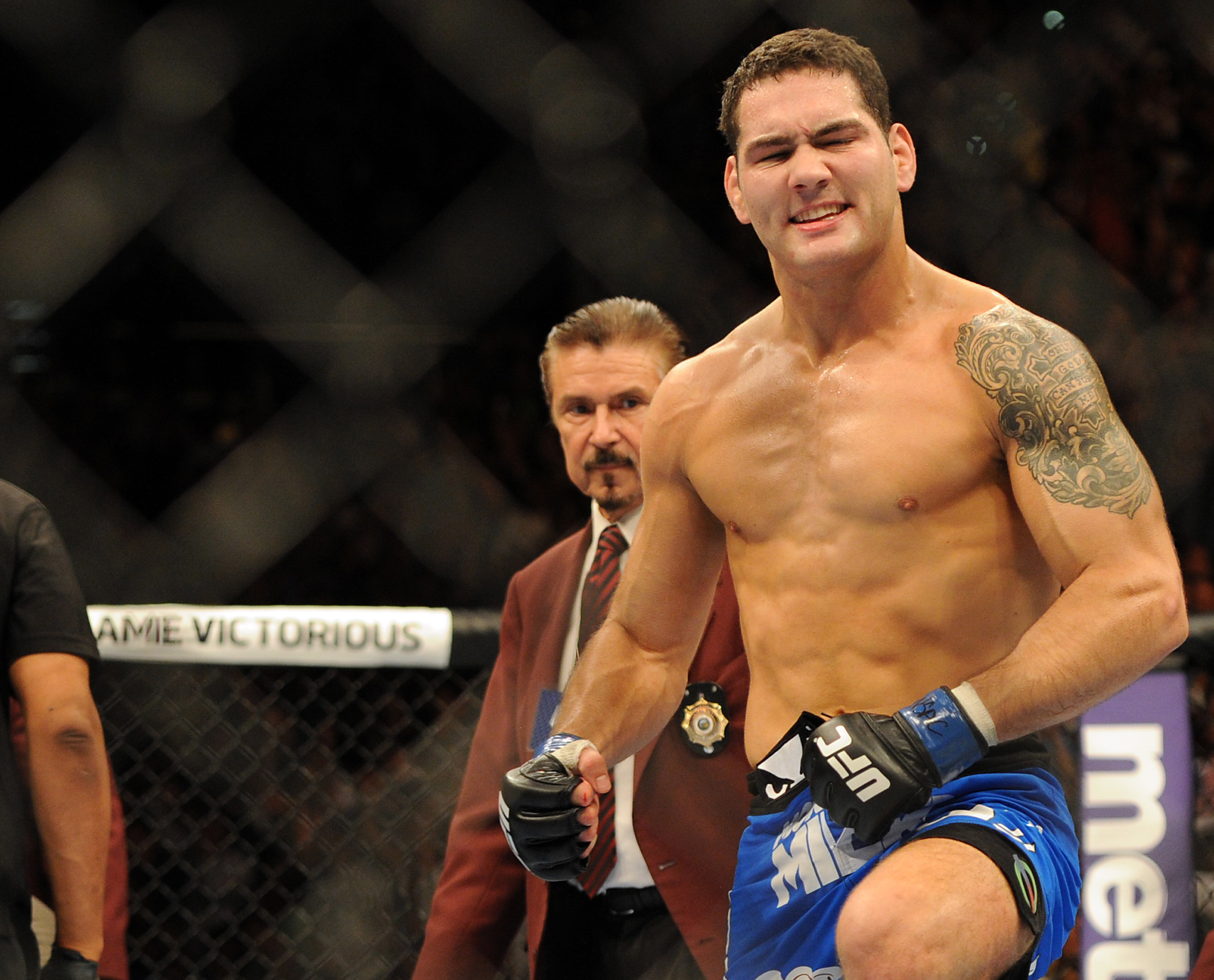 Chris Weidman celebrates after knocking out Anderson Silva. (USA Today)