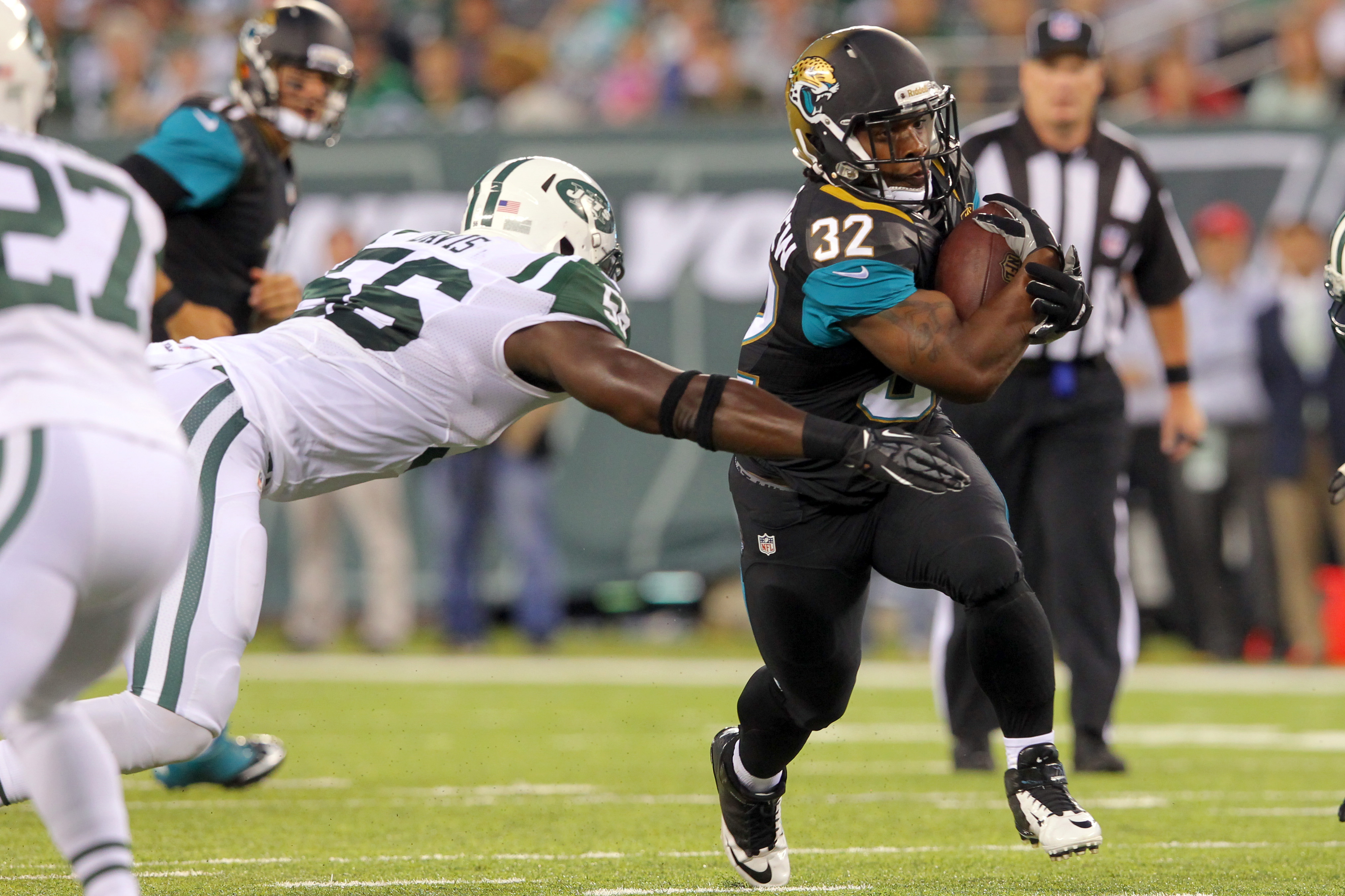 Maurice Jones-Drew runs by Jets linebacker DeMario Davis in a preseason game. (USAT Sports)