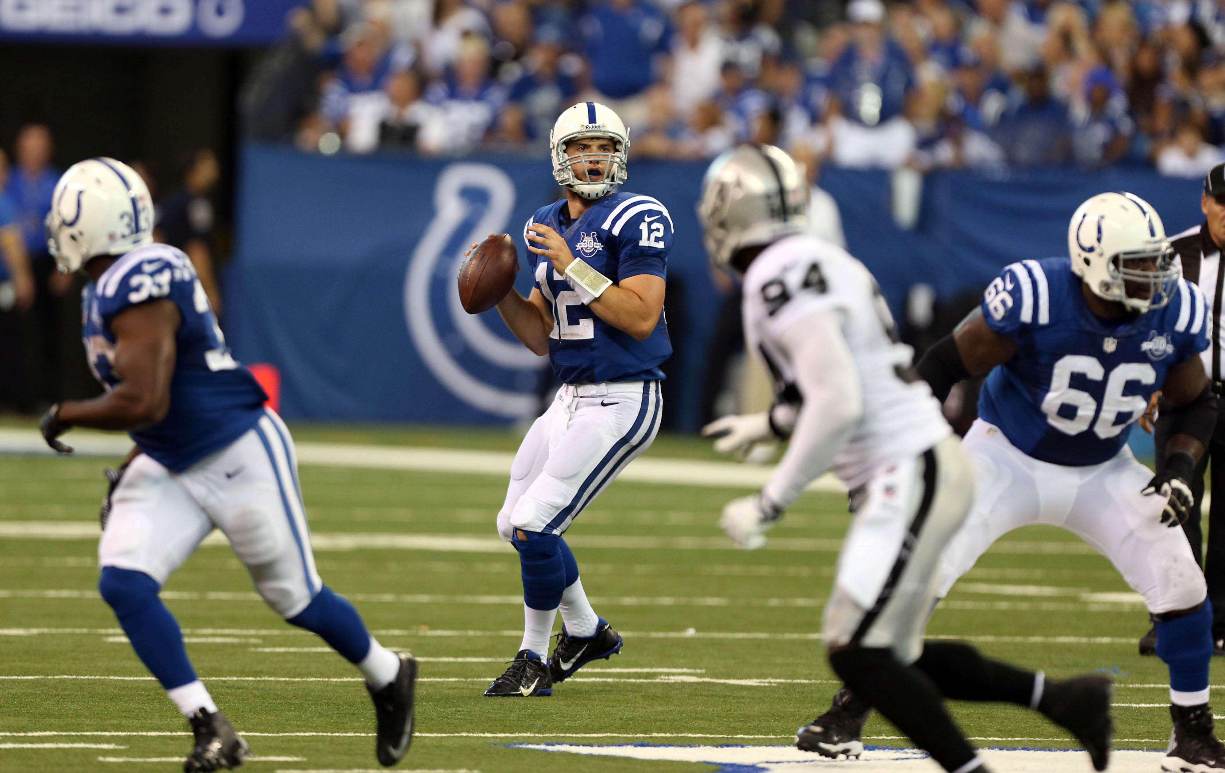 Andrew Luck had a hard time letting go (of the football) in Week 1. (USAT)