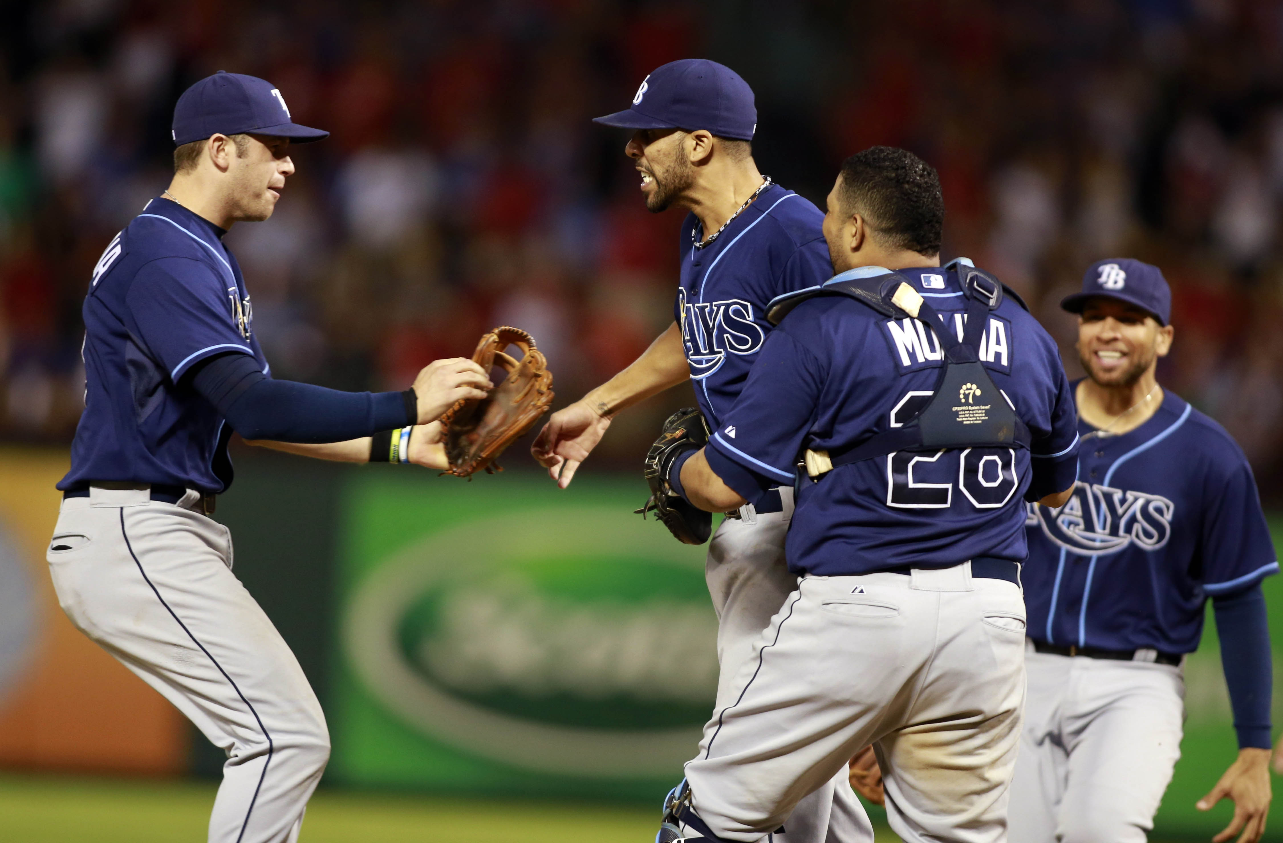 David Price (middle) and the Rays celebrate their victory over the Rangers. (USA Today)