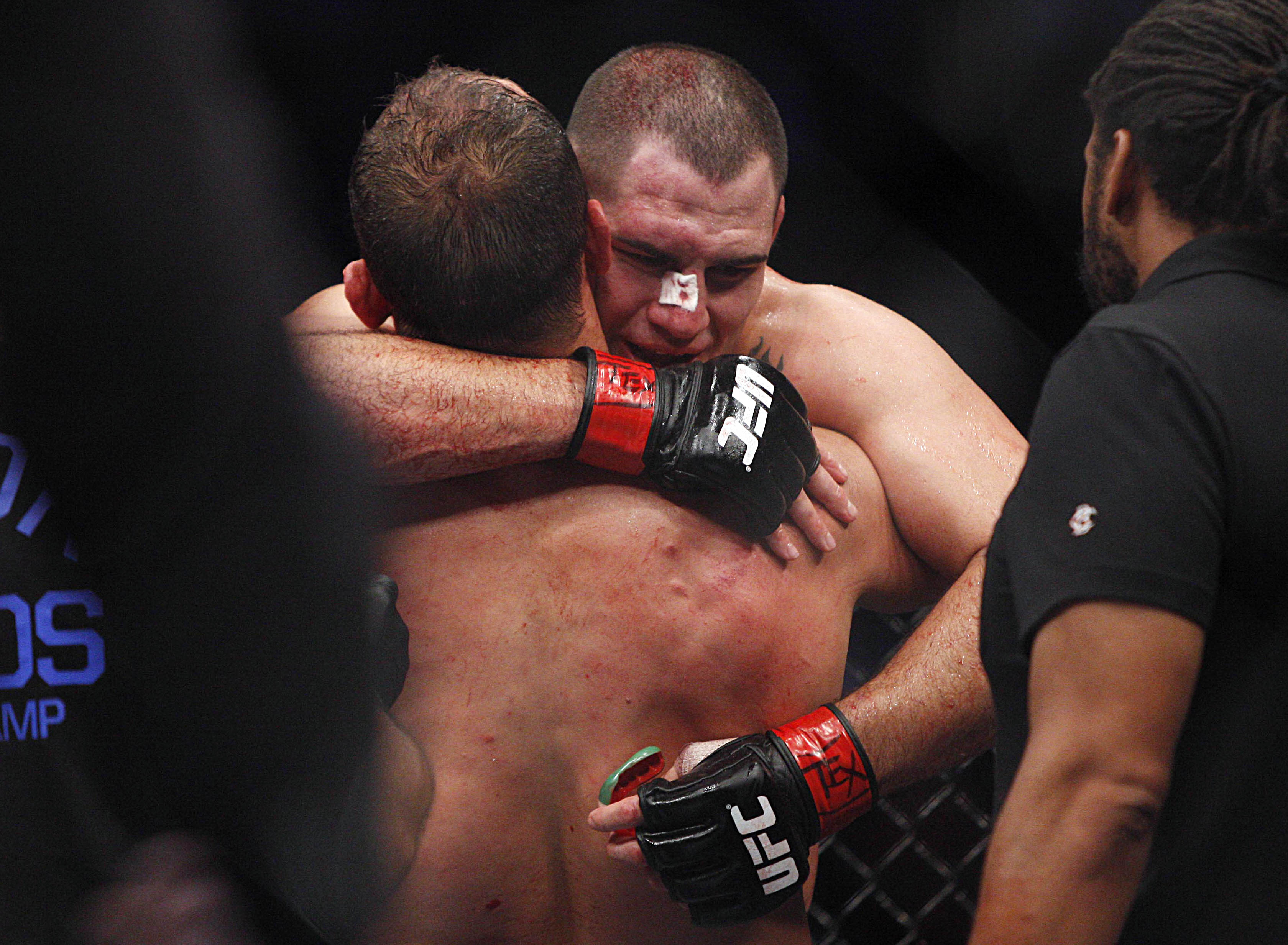 Cain Velasquez embraces Junior Dos Santos after their fight. (USA Today)