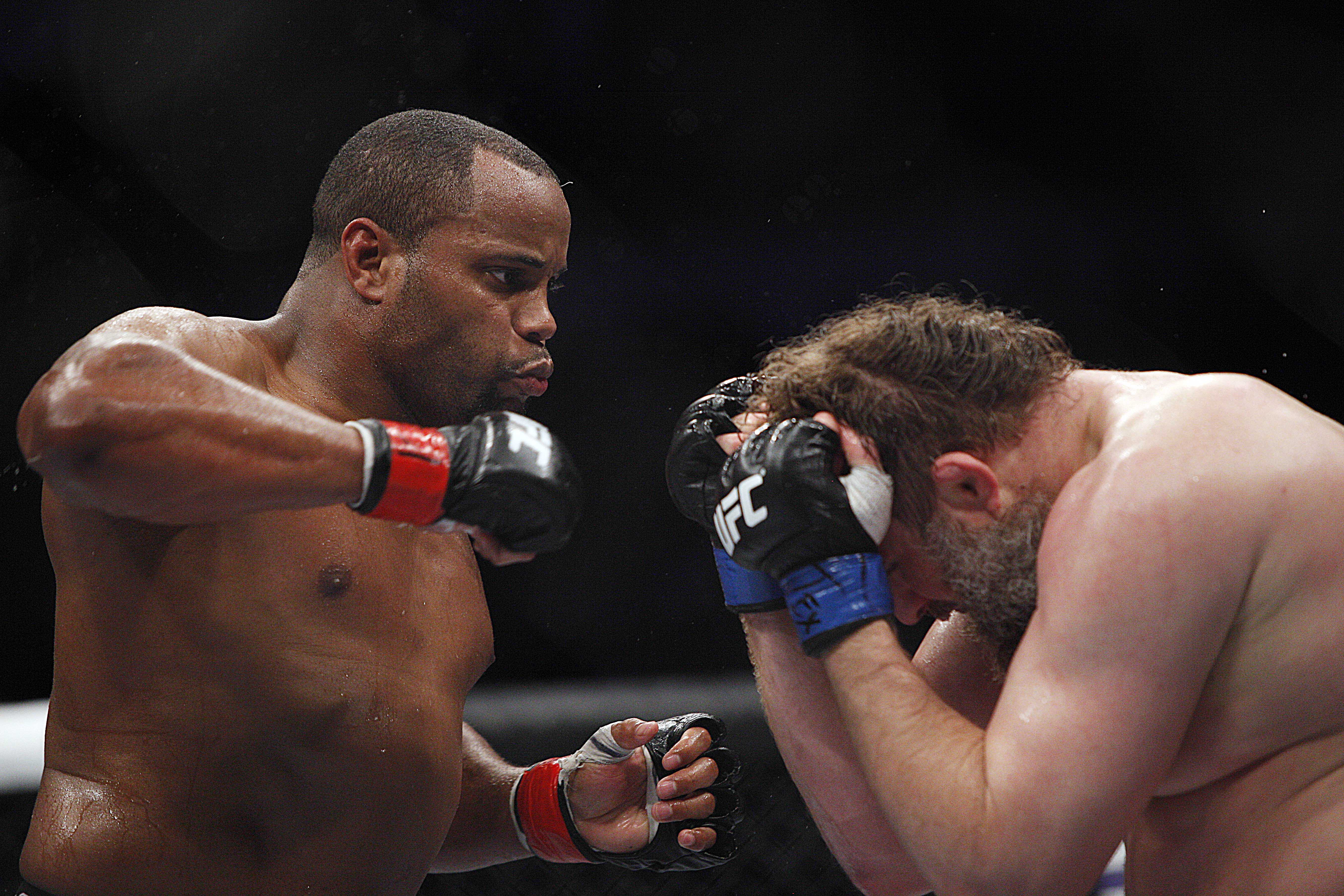 Daniel Cormier (red gloves) fights against Roy Nelson (blue gloves). (USA Today)