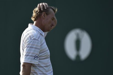 Golf-Blood spilt as Els says he put 'jinx' on his group