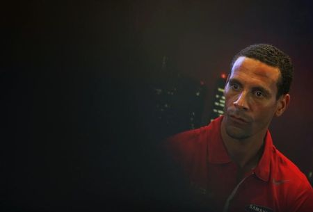 Soccer-Ferdinand charged by FA over Twitter comment