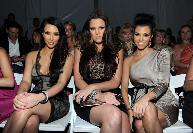 Kim, Khloe and Kourtney Kardashian attend the Beach Bunny Swimwear 2011 fashion show during Mercedes-Benz Fashion Week Swim at The Raleigh, Miami Beach, July 16, 2010