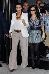 Kim Kardashian and Kourtney Kardashian are surrounded by photographers as they leave their Midtown Manhattan hotel in NYC on October 7, 2011 -- Getty Premium