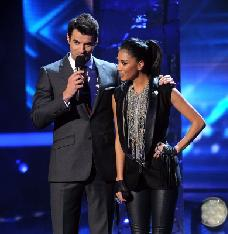 Steve Jones and judge Nicole Scherzinger onstage at FOX's 'The X Factor' Top 4 to 3 Live Elimination Show, Los Angeles, on December 15, 2011 -- Getty Premium