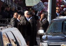 Bobby Brown and entourage exit Whitney Houston's funeral in Newark, New Jersey, on February 18, 2012 -- Getty Images