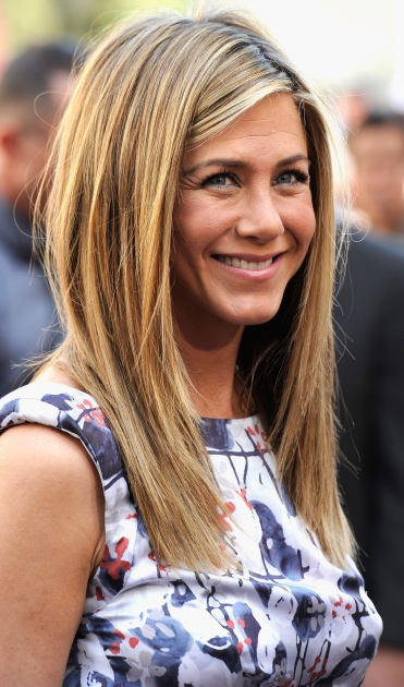 Jennifer Aniston is all smiles while she was honored with a star on the Hollywood Walk Of Fame in Hollywood, Calif. on February 22, 2012  -- Getty Images