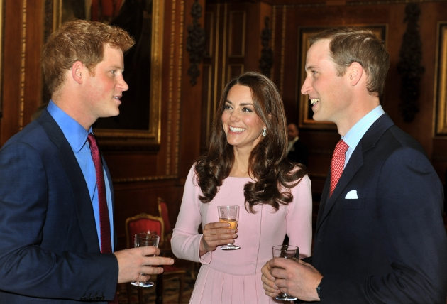 Catherine, Duchess of Cambridge and Prince William, Duke of Cambridge speak to Prince Harry during a reception at Windsor Castle in Windsor, England Catherine, Duchess of Cambridge and Prince William, Duke of Cambridge speak to Prince Harry during a reception in the Waterloo Chamber, before the Lunch For Sovereign Monarchs at Windsor Castle, on May 18, 2012