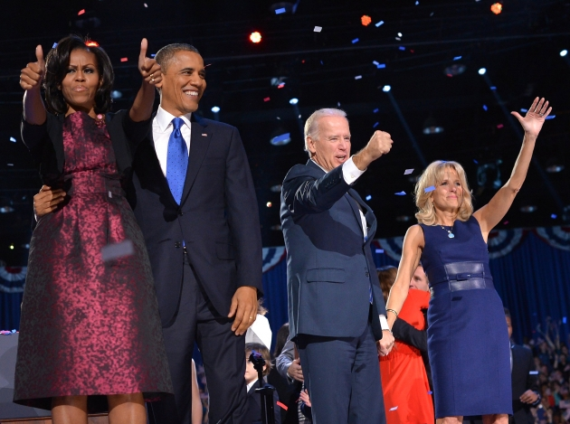 President Barack Obama flanked by First Lady Michelle Obama, and Vice-President Joe Biden and Second Lady Jill Biden wave to supporters following Obama&#39;s speech on election night November 6, 2012 in Chicago -- Getty Premium