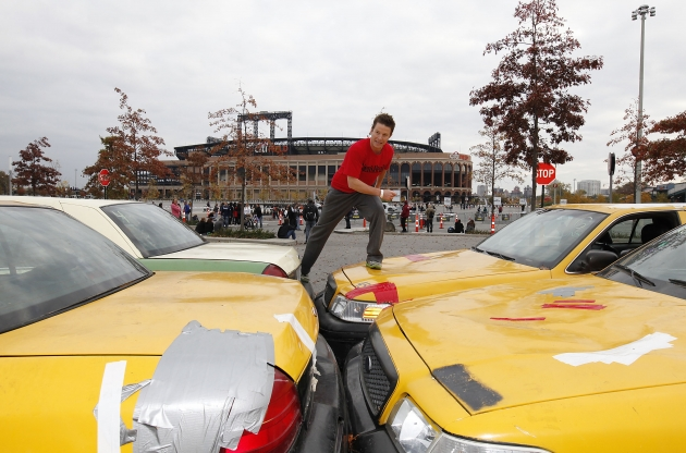Billy Bush tackles the taxi obstacle at Men's Health urbanathlon -- Men's Health