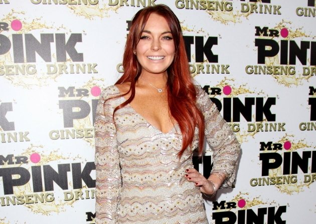 Lindsay Lohan arrives at Mr. Pink Ginseng Drink Launch Party in Beverly Hills, Calif., on October 11, 2012 -- Getty Premium