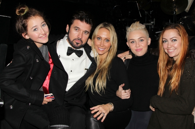 Billy Ray Cyrus poses with his family backstage at the hit musical &#39;Chicago&#39; on Broadway at The Ambassador Theater in New York City on November 18, 2012 -- Getty Premium