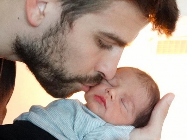 Gerard Pique seen with his newborn son Milan on February 4, 2013  -- Shakira