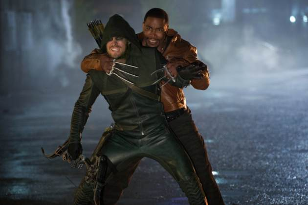 "Stephen Amell as Arrow and Michael Jai White as Bronze Tiger in ""Arrow"""