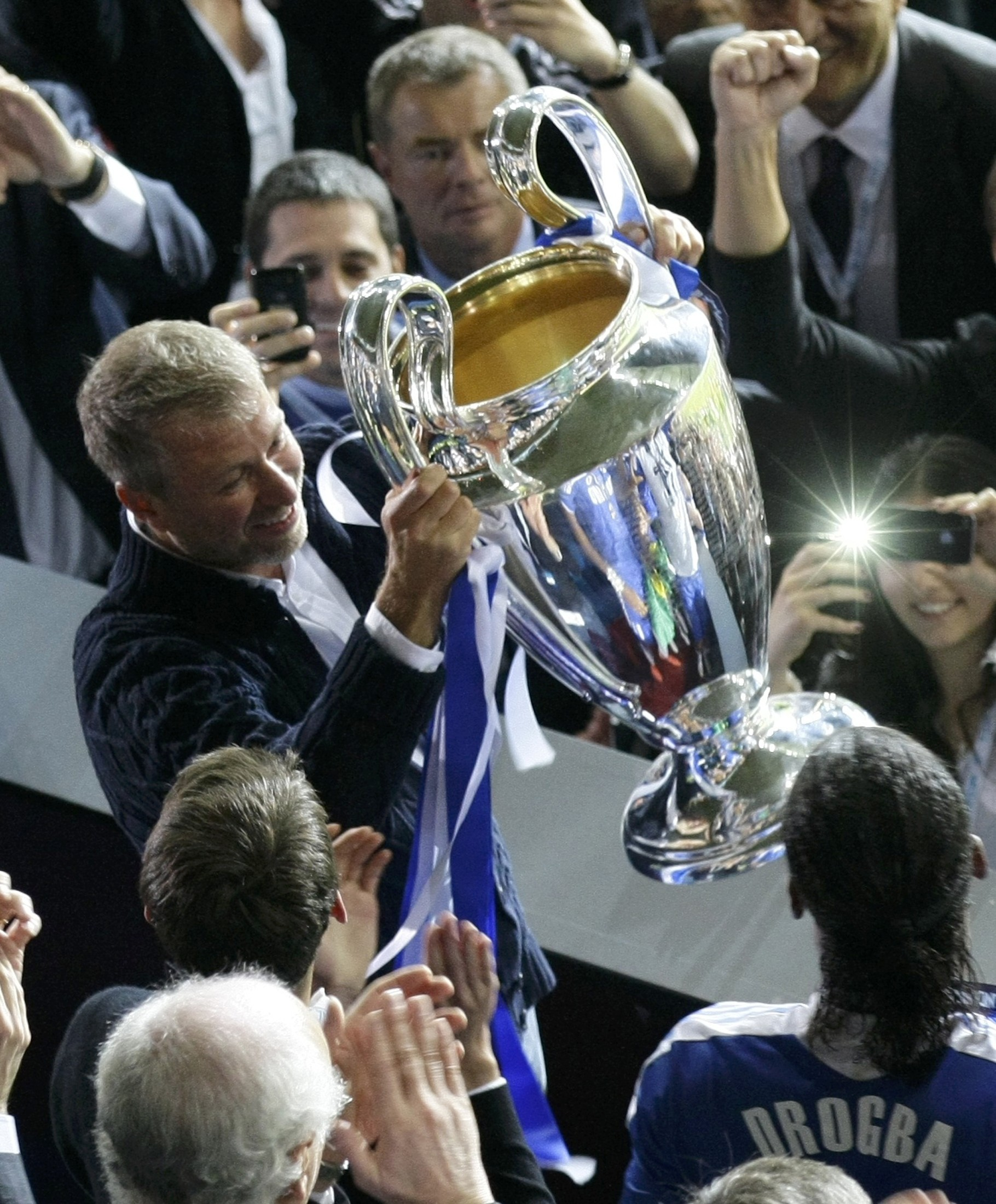 Chelsea owner Roman Abramovich lifts the UEFA Champions League trophy. (Reuters)