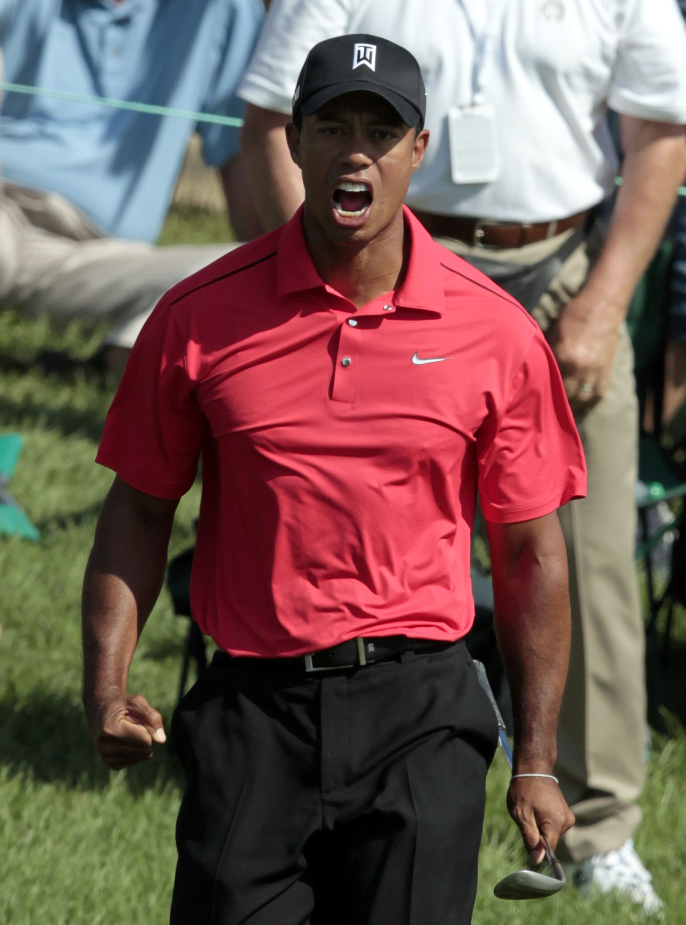 Tiger Woods roared with gusto after chipping in for a birdie on 16. (TPX)