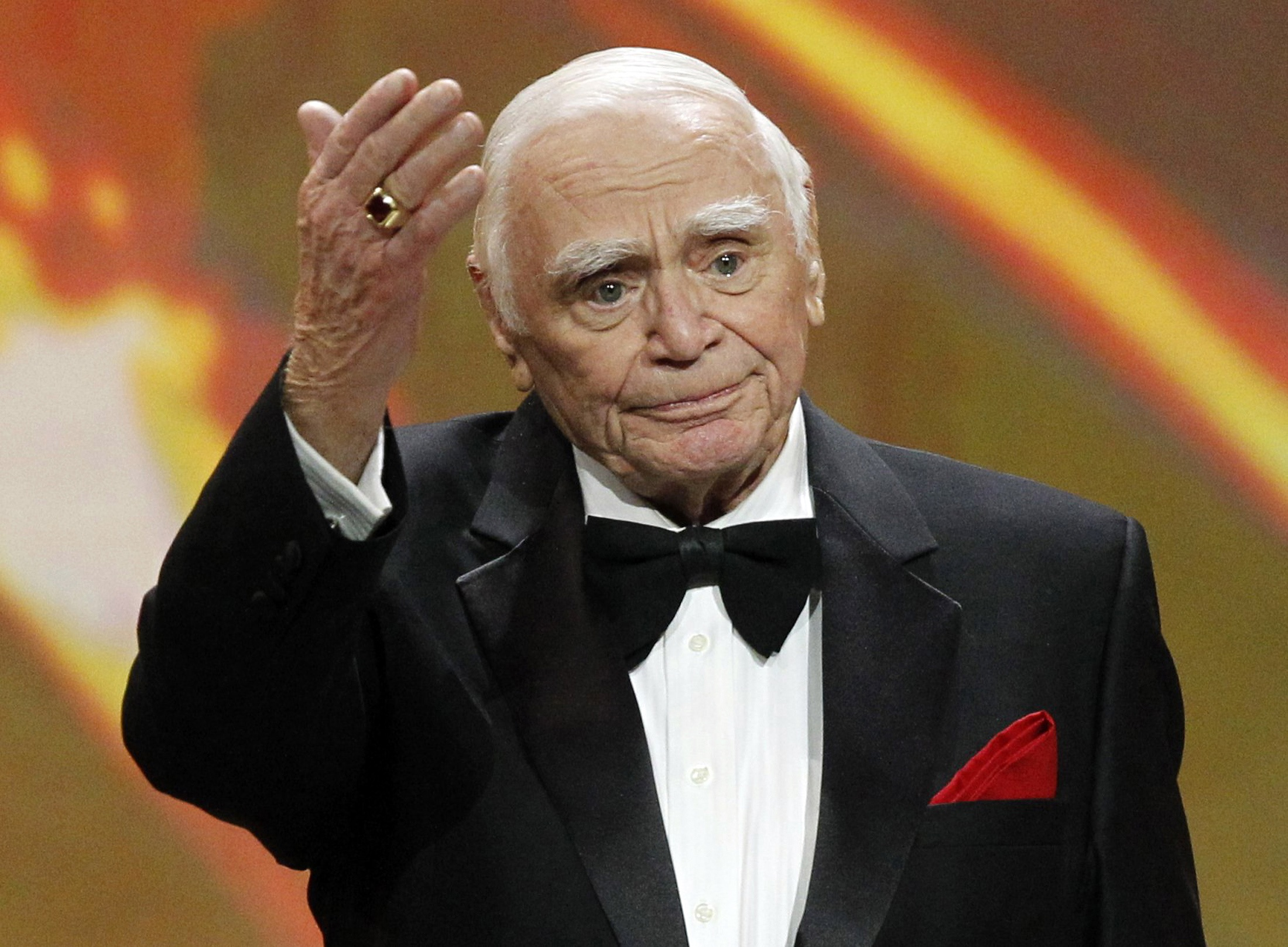 Lifetime achievement honoree Ernest Borgnine waves after receiving his award at the 17th annual Screen Actors Guild Awards in Los Angeles in 2011. Borgnine died at the age of 95, his longtime publicist said. (REUTERS/Mario Anzuoni)