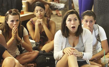 Laura Lovins and fellow students react to the penalties handed down by the NCAA. (Reuters)