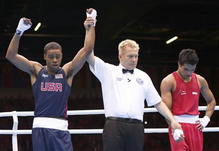 Errol Spence's arm was raised despite the decision initially going against him. (Reuters)