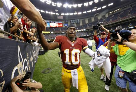 Robert Griffin III emerges victorious after his first career start as a professional. (Reuters)