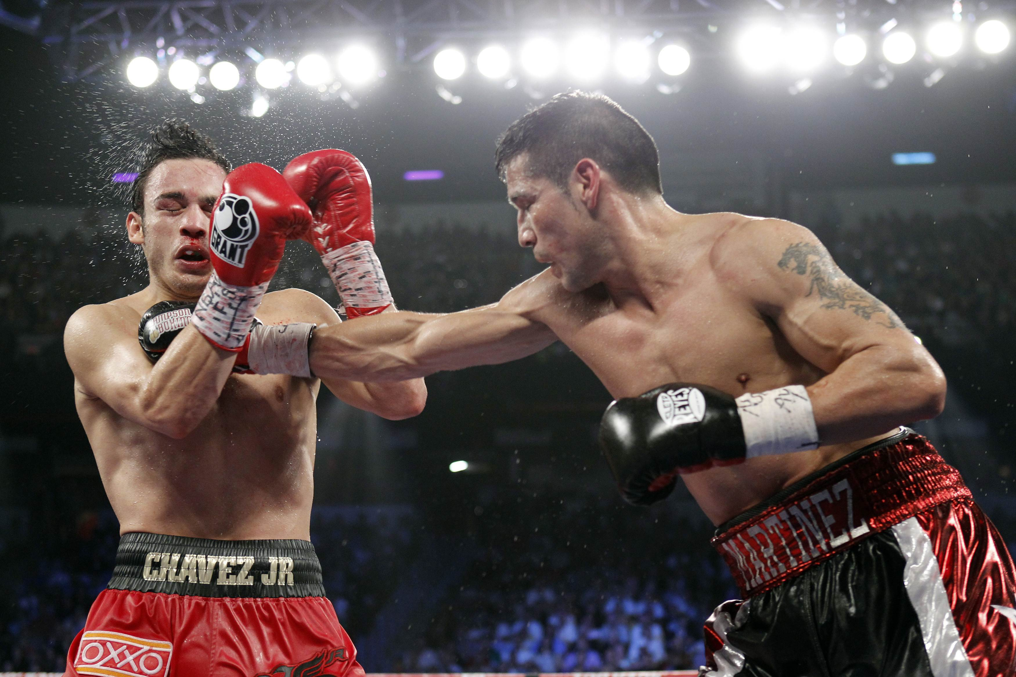 Julio Cesar Chavez Jr. takes a punch from Sergio Martinez during their title fight. REUTERS/Steve Marcus