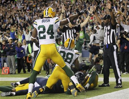 Packers defenders look on as officials signal TD at the end of Monday night's game. (REUTERS)
