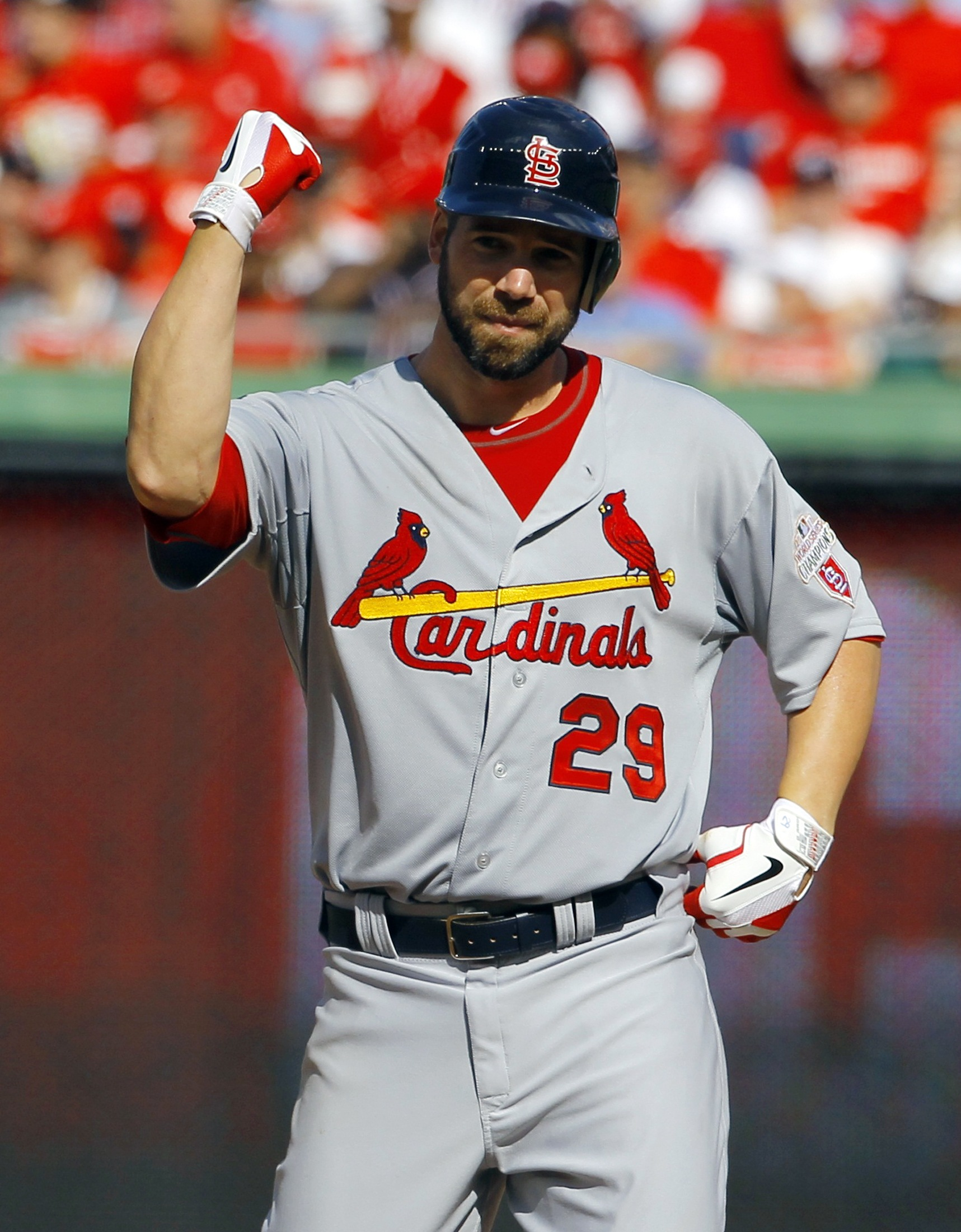 In addition to holding the Nationals in check, Chris Carpenter also had two hits. (Reuters)