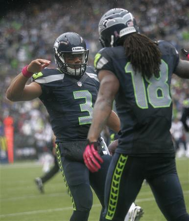 Russell Wilson (3) congratulates teammate Sidney Rice after his game-tying TD catch. (Reuters)