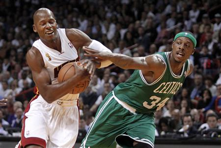 Paul Pierce fouls Ray Allen in the first half on Tuesday. (Reuters)