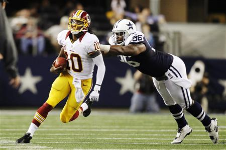 Robert Griffin III scrambles away from Cowboys DT Marcus Spears in the second half of last Thursday's victory. (REUTERS)