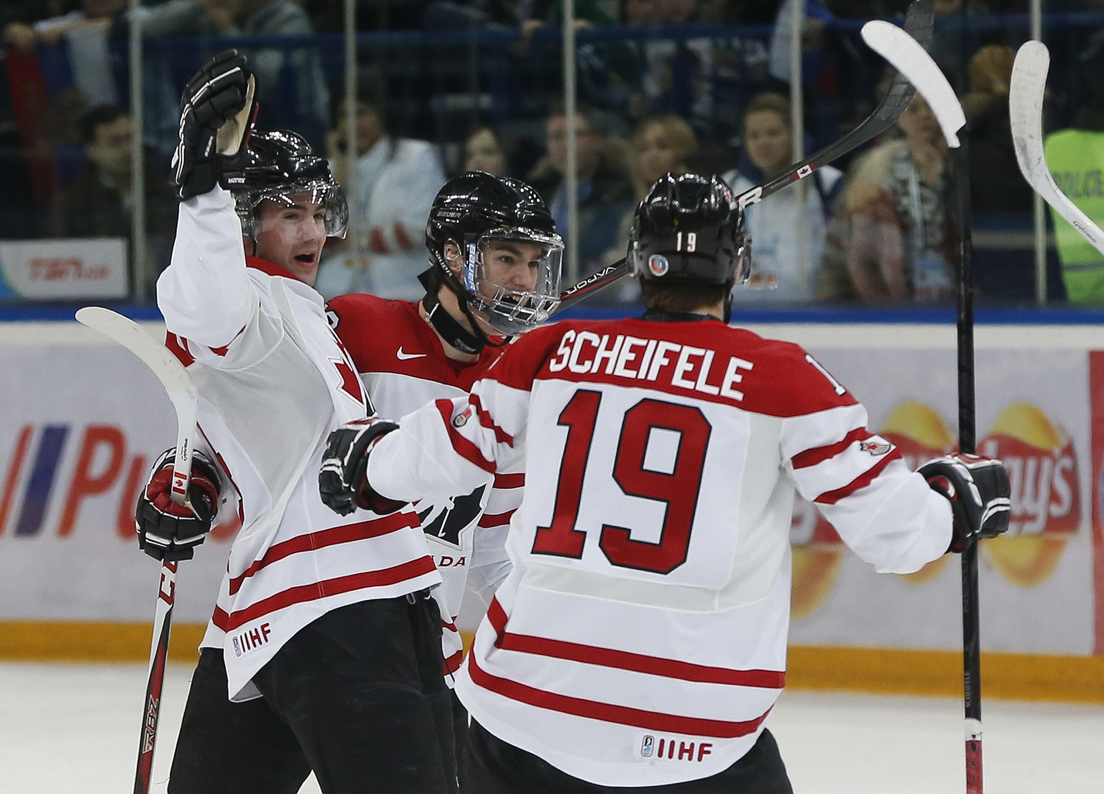 Ryan Murphy, Jonathan Drouin and Mark Scheifele celebrate Drouin's goal against Russia. (Reuters)