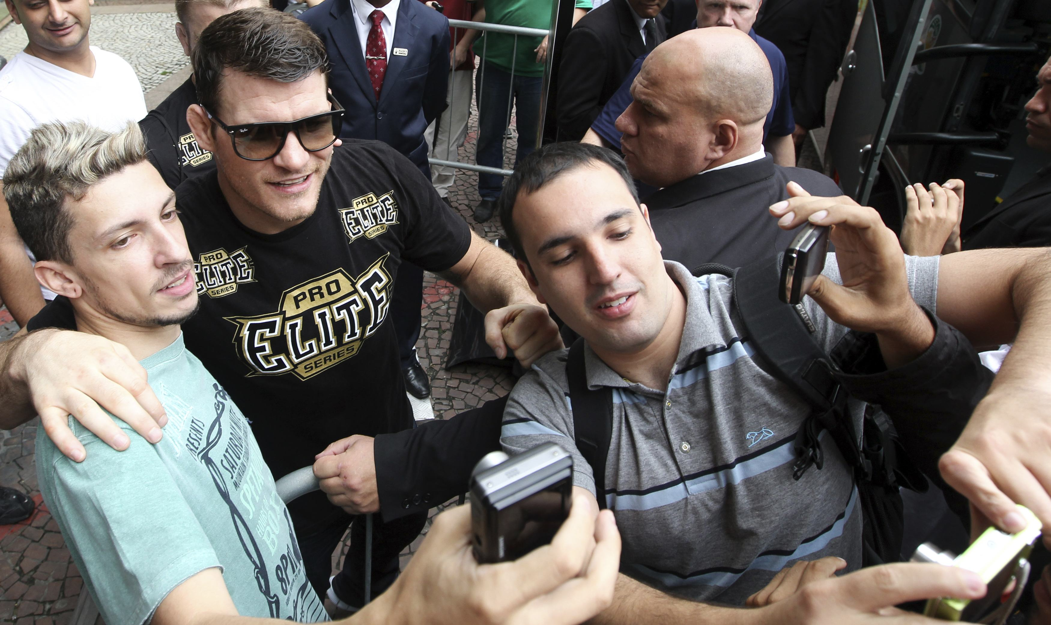 Michael Bisping poses for pictures with Brazilian fans in Sao Paulo. (Reuters)