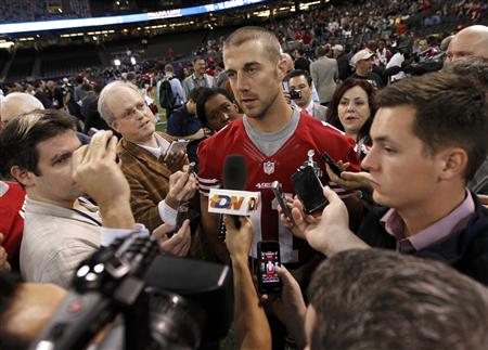 Alex Smith is surrounded by journalists during media day. (REUTERS)