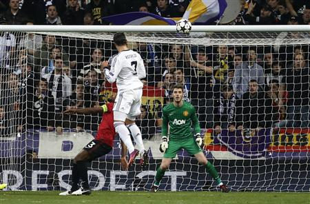 Cristiano Ronaldo scores past Manchester United goalkeeper David de Gea. (Reuters)