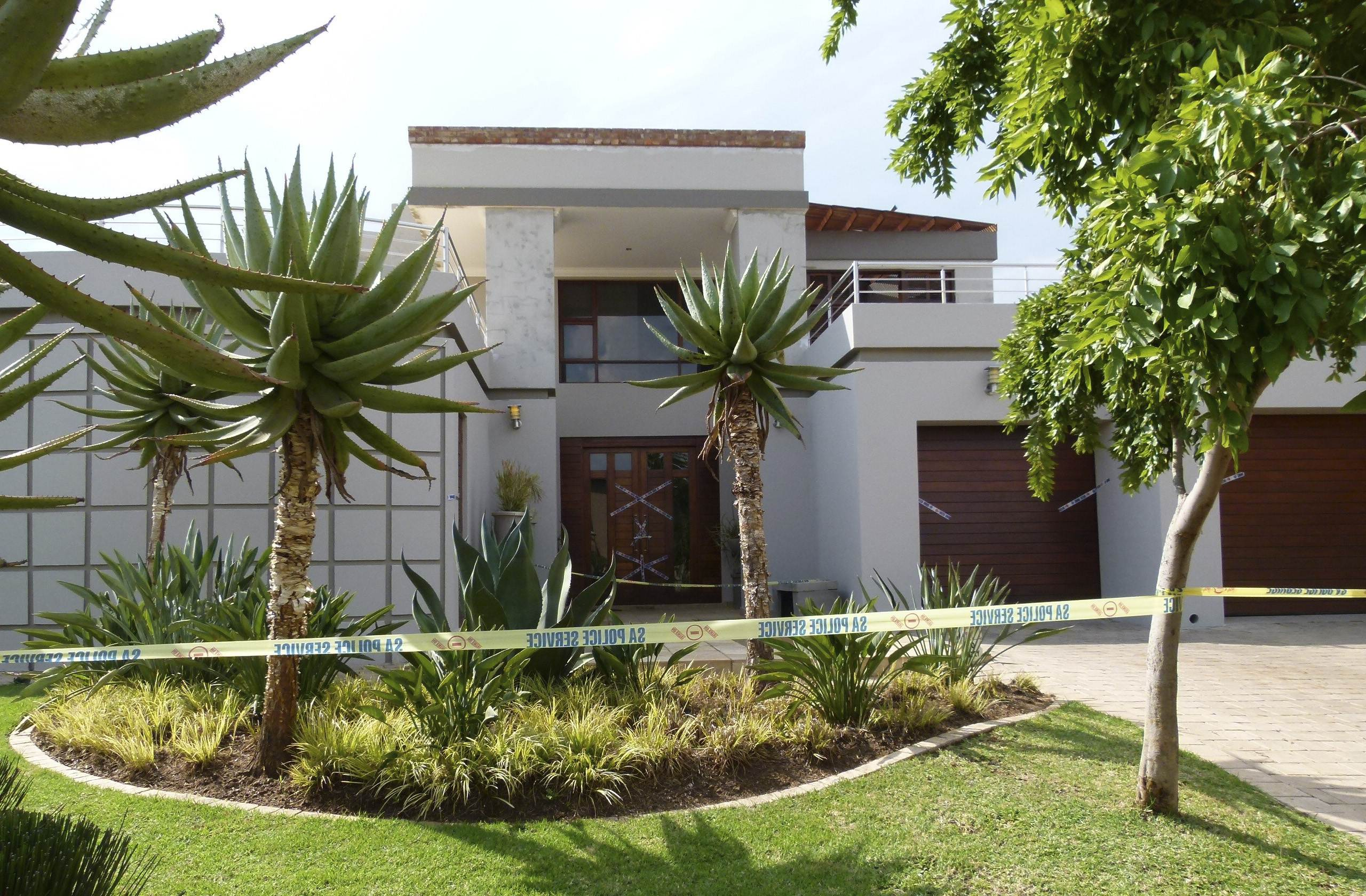 "Police crime scene tape marks off the Pretoria home of South African ""Blade Runner"" Oscar Pistorius. (REUTERS)"