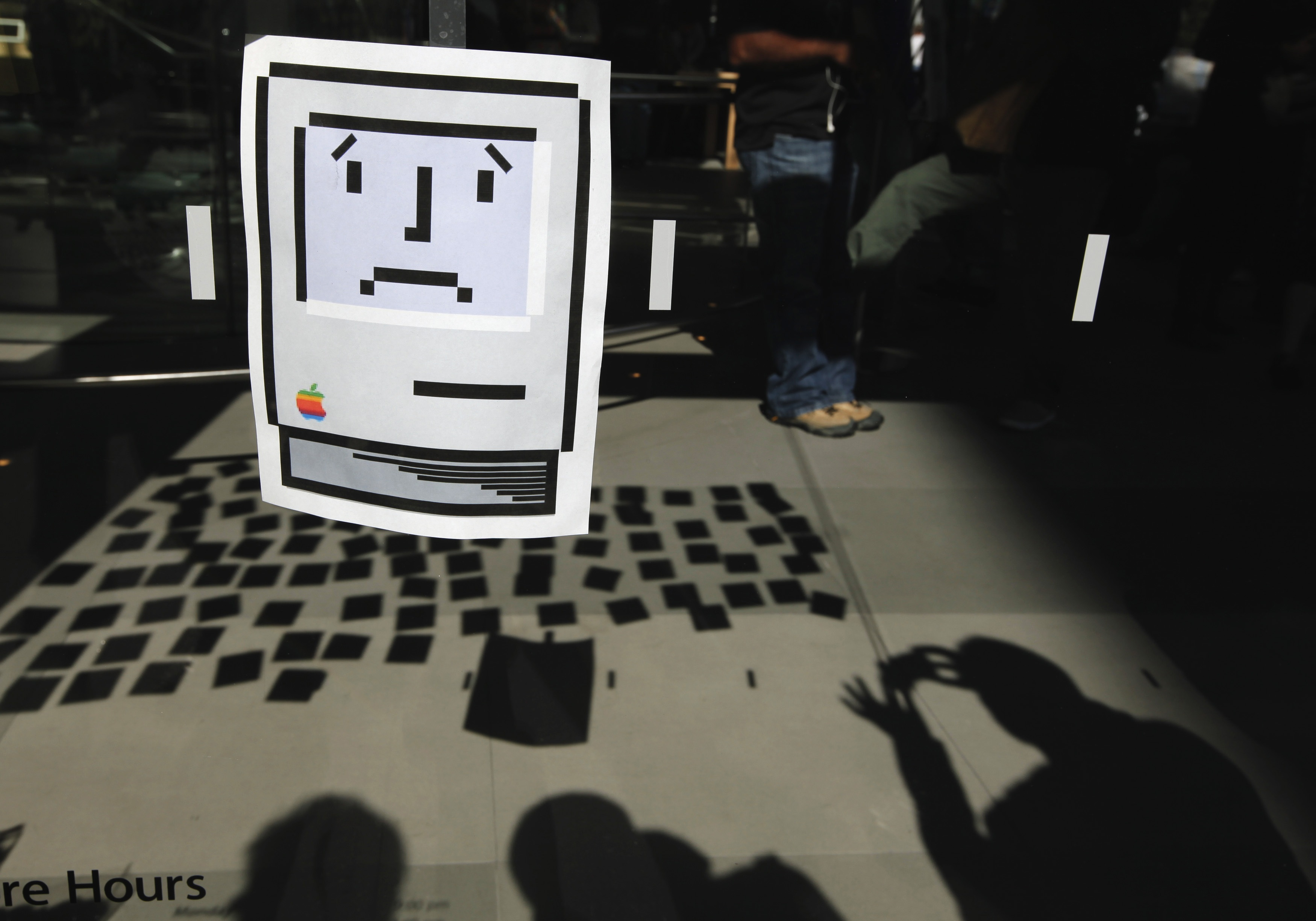 A sad Macintosh icon is seen on the exterior of Apple's 14th St store in New York. REUTERS/Lucas Jackson/Files