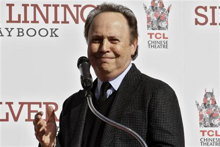 Actor Billy Crystal speaks during a hand and footprint ceremony for actor Robert DeNiro at the TCL Chinese Theatre in Hollywood, California, February 4, 2013. REUTERS/Jonathan Alcorn
