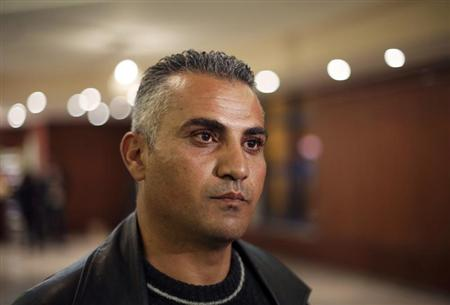 Palestinian journalist Emad Burnat pauses while he speaks to members of the media before a screening of his Oscar-nominated documentary &quot;5 Broken Cameras&quot; in the West Bank city of Ramallah January 28, 2013. REUTERS/Mohamad Torokman