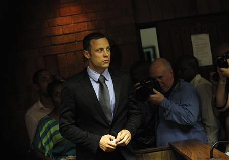 Oscar Pistorius enters the dock during a break in court proceedings. (REUTERS)