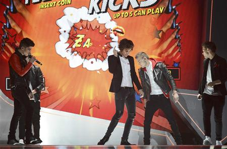 Pop group One Direction performs during the BRIT Awards, celebrating British pop music, at the O2 Arena in London February 20, 2013. REUTERS/Dylan Martinez