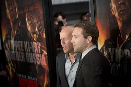 Cast members Jai Courtney (R) and Bruce Willis meet with fans to celebrate the opening of their new film &quot;A Good Day To Die Hard&quot; in New York February 13, 2013. REUTERS/Andrew Kelly