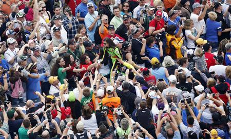 Danica Patrick greets fans before the start of the Daytona 500. (REUTERS)